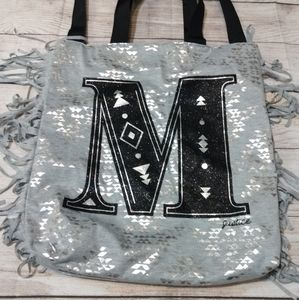 JUSTICE large monogramed tote
